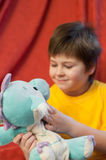 boy with  toy dragon - symbol of the new year Stock Image