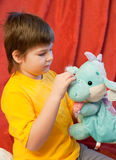 Boy with  toy dragon - symbol of the new year Stock Images