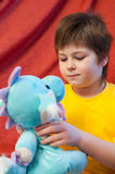 Boy with  toy dragon - symbol of the new year Stock Photo
