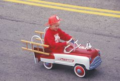 Boy in Toy Fire truck in July 4th Parade, Cayucos, California Stock Image