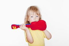 Boy with toy guitar Stock Images