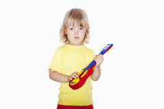 Boy with toy guitar Stock Photography