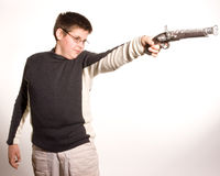 Boy With Toy Gun. Boy shooting a toy musket stock image