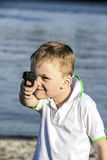 A boy and a toy gun Stock Images