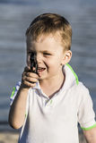 A boy and a toy gun Royalty Free Stock Images