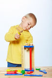 Boy with toy hammer stock photo