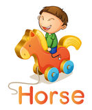 A boy on a toy horse Royalty Free Stock Photography