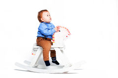 Boy on toy horse Stock Photos