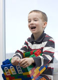 A boy and a toy house. Stock Images