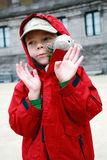 Boy with toy lambkin Royalty Free Stock Photos