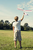 Boy with a toy plane Stock Photography