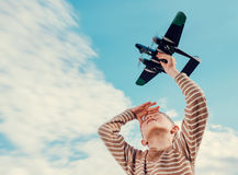 Boy with toy plane Stock Image