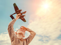 Boy with toy plane. Tith sky background stock photography