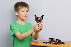 Boy with a toy of plastic parts Royalty Free Stock Image