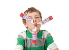 Boy with toy propeller in mouth isolated Royalty Free Stock Photos