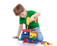 Boy toy repairs Stock Photos