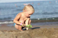 Boy with toy scoop Royalty Free Stock Images