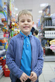 Boy in toy section in shop Royalty Free Stock Photo