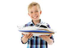 Boy with toy ship in hands Stock Photo