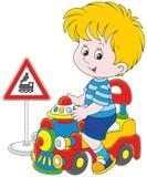Boy on a toy train Stock Photos