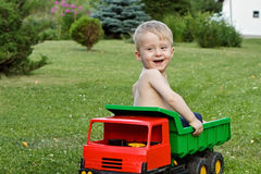 Boy in a toy truck Royalty Free Stock Photo