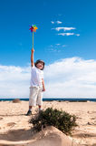 Boy with the toy windmill Royalty Free Stock Photo