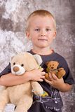 Boy with toys Royalty Free Stock Images
