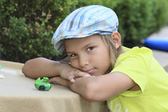 Boy with toys. Boy plays with toys out doors Stock Photography