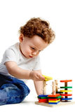 Boy with toys. Small boy sit and playing with colorful toys Royalty Free Stock Images