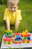 Boy with toys stock photos