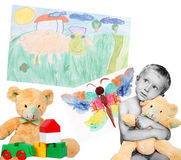 Boy with toys and drawings royalty free stock photo