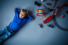 Boy with toys. Little boy with toys in studio Royalty Free Stock Images