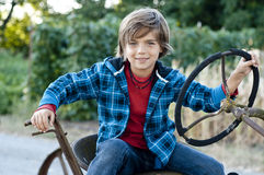 Boy with tractor Royalty Free Stock Image
