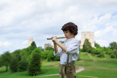 A boy in traditional Bavarian clothes with a shepherd`s pipe Royalty Free Stock Image