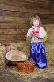 Boy in traditional ukrainian clothes on hayloft Royalty Free Stock Photo