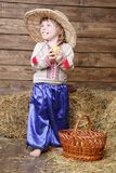 Boy in traditional ukrainian clothes on hayloft Stock Photo