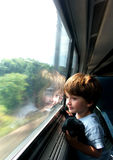 Boy on train. Boy looking out window of train Royalty Free Stock Image