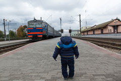 Boy and train Stock Images