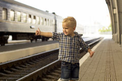 Boy at the train station. Waiting for the train Stock Image