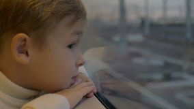 Boy by the Train Window stock footage