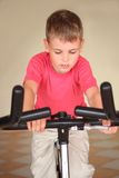 Boy on training apparatus Royalty Free Stock Images