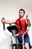 Boy on training apparatus in sportclub Royalty Free Stock Image
