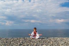 The boy training on the beach: Taekwondo, sports Stock Image
