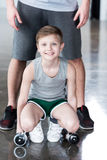Boy training with dumbbells together with coach Royalty Free Stock Photos
