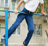 Boy training on a horizontal bar. In the park in nature Royalty Free Stock Images