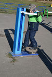 Boy training on the outdoor equipment Royalty Free Stock Photography