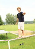 Boy training stability Royalty Free Stock Image