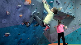 Boy trains in climbing stock footage