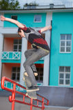 Boy trains on skateboard in evening skatepark Stock Image