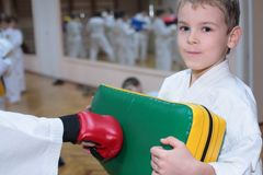 Boy trains in sports hall stock photos